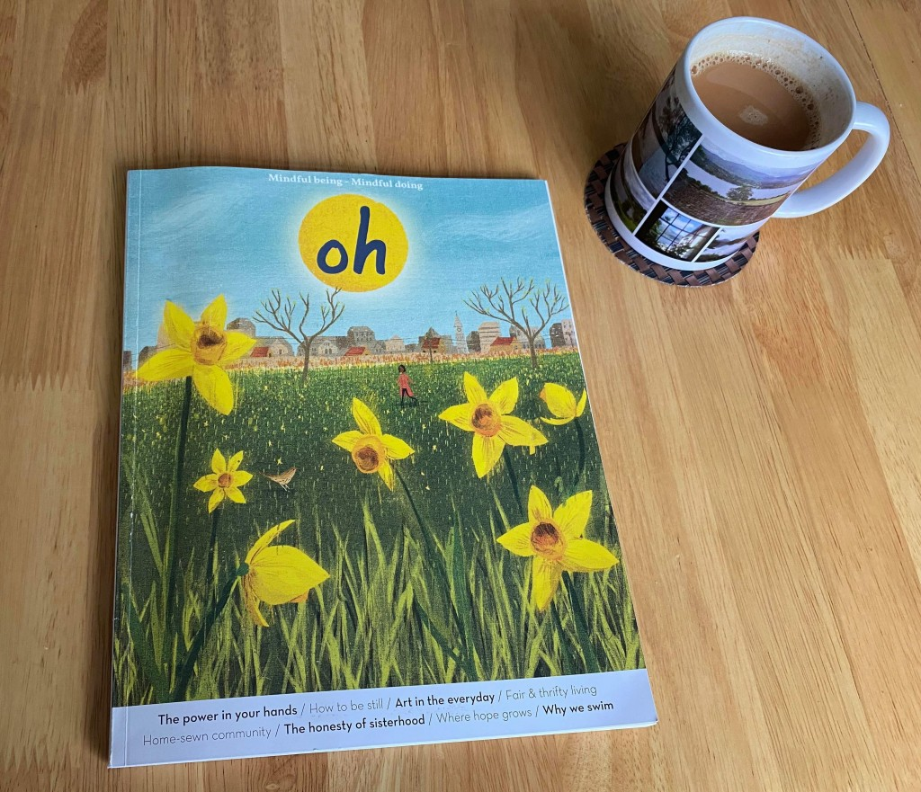 Photo shows front cover of Oh magazine with an illustration of daffodils