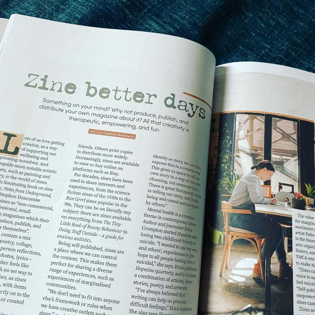 Photo shows an open magazine on an article about zines